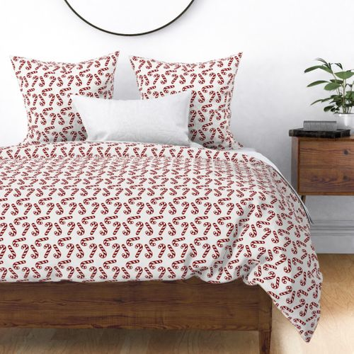 Large Dark Christmas Candy Apple Red Candy Canes on White Duvet Cover
